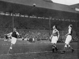 Acrobatics in a Arsenal V Chelsea Match at Stamford Bridge, London, C1933-C1938 by Sport & General