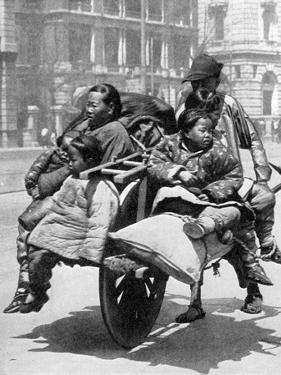 Chinese Family on a Cart, 1936 by Sport & General