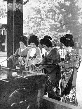 Japanese Women Washing their Hands Prior to Entering a Temple, 1936 by Sport & General