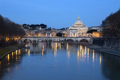 https://imgc.allpostersimages.com/img/posters/st-peter-s-basilica-the-river-tiber-and-ponte-sant-angelo-at-night-rome-lazio-italy_u-L-PWFIAB0.jpg?artPerspective=n