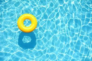 Yellow Pool Float, Ring Floating in a Refreshing Blue Swimming Pool by StacieStauffSmith Photos