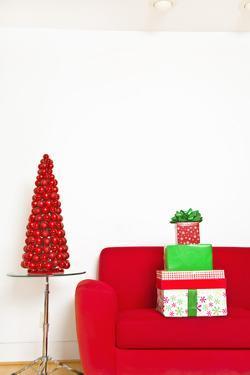Stack of Christmas Gifts on Sofa