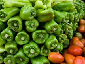 Stack of Fresh Green Bell Peppers at Marketplace