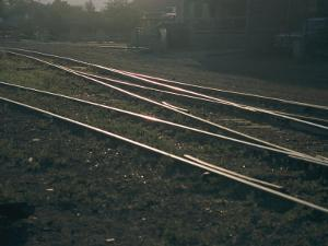 Morning Sun Highlights the Tracks of This Railroad That Runs Through Santa Fe, New Mexico by Stacy Gold