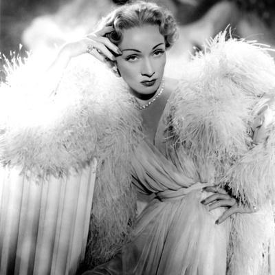 https://imgc.allpostersimages.com/img/posters/stage-fright-marlene-dietrich-wearing-a-christian-dior-design-1950_u-L-PH331T0.jpg?artPerspective=n
