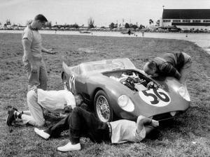Men Fixing Their Race Car During the Grand Prix by Stan Wayman