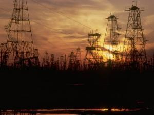 Oil Derricks at Sunset at Baku, Azerbaijan, USSR by Stan Wayman