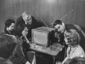 People Watching Senator John F. Kennedy on TV After His Victory in the Primary Election by Stan Wayman