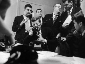 Senator John F. Kennedy Talking on the Phone Surrounded by Aides During the Primary Elections by Stan Wayman