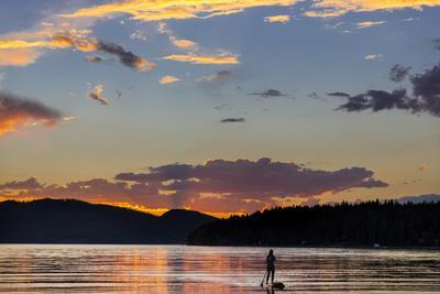 https://imgc.allpostersimages.com/img/posters/standup-paddleboarder-silhouetted-by-sunset-whitefish-lake-montana_u-L-PU3EUF0.jpg?artPerspective=n