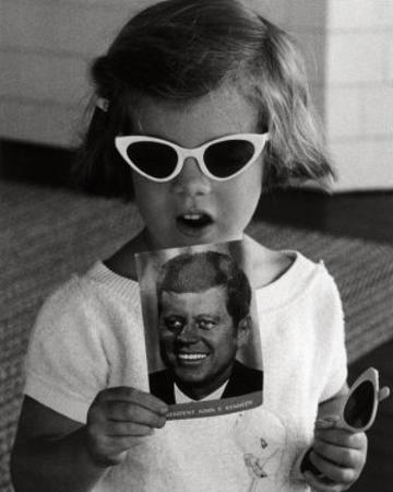 Caroline Kennedy holds a Postcard of her Father, 1961 by Stanley Tretick