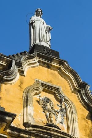 https://imgc.allpostersimages.com/img/posters/statue-atop-the-baroque-facade-of-the-iglesia-de-la-recoleccion-church_u-L-PWFFW70.jpg?p=0