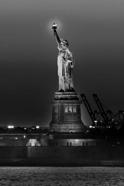 Statue of Liberty sunset. NYC harbor, Manhattan