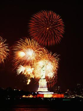 Statue of Liberty with a Celebration of Bright Fireworks in Manhattan, New York