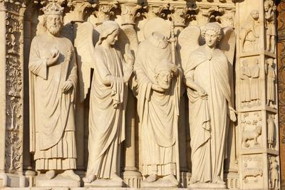 https://imgc.allpostersimages.com/img/posters/statues-including-the-emperor-constantine-and-st-denis-carrying-his-head-notre-dame-cathedral_u-L-Q1GYLKP0.jpg?artPerspective=n