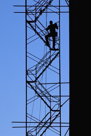 Steelworker Assembling Scaffolding