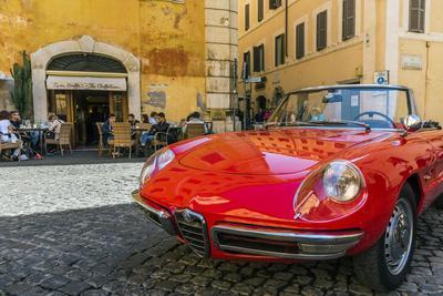 Alfa Romeo Duetto spider parked in a cobblestone street of Rome, Lazio, Italy