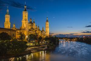 Basilica De Nuestra Senora Del Pilar Church and Ebro River at Dusk, Zaragoza, Aragon, Spain by Stefano Politi Markovina