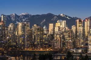 Downtown skyline with snowy mountains behind at dusk, Vancouver, British Columbia, Canada by Stefano Politi Markovina
