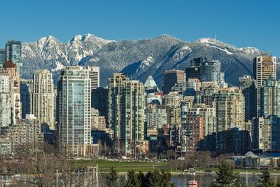 Downtown skyline with snowy mountains behind, Vancouver, British Columbia, Canada