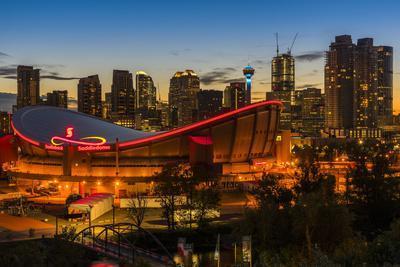 Night view of Saddledome stadium and city skyline, Calgary, Alberta, Canada