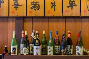 Sake Bottles in a Sake Brewery, Takayama, Gifu Prefecture, Japan by Stefano Politi Markovina