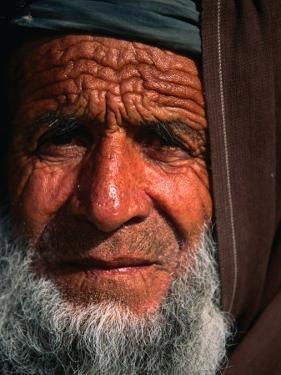 Bearded Afghan Man, Looking at Camera, Mazar-E Sharif, Afghanistan by Stephane Victor