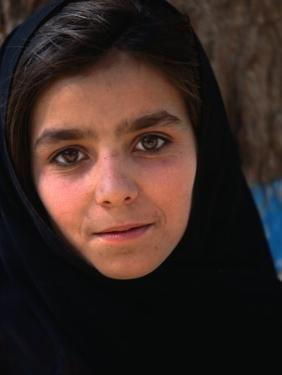Girl at Aschiana School, Looking at Camera, Kabul, Afghanistan by Stephane Victor