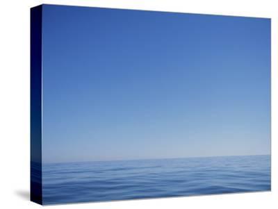 Calm Ocean and Blue Sky off the Coast of North Carolina by Stephen Alvarez