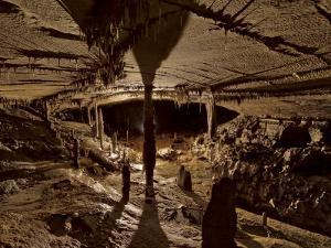 Iron Hoop cave chamber with an accumulation of mineral deposits by Stephen Alvarez