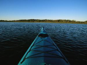 Kayak Sits in the Marsh Around Carrot Island Before Sunset by Stephen Alvarez