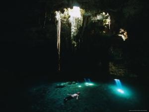 Man Swimming in the Sunlit Cenote by Stephen Alvarez