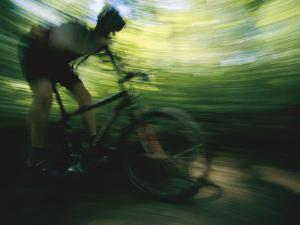 Panned Shot of a Mountain Biker by Stephen Alvarez