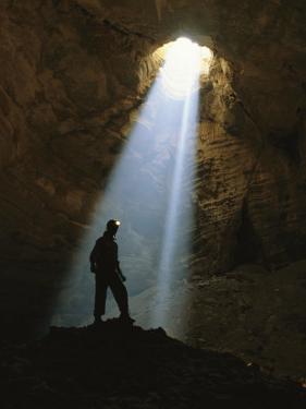 Sunlight Streams Through the 518-Foot Drop into Majlis Al Jinn by Stephen Alvarez