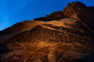The Butler Wash petroglyph panel in the San Juan River Canyon. by Stephen Alvarez