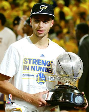 Stephen Curry with the Western Conference Finals Trophy