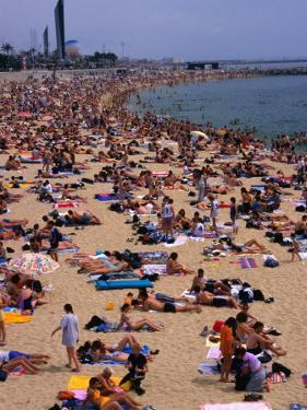 Crowded Beach of Platja De La Nova Icaria, Barcelona, Spain by Stephen Saks