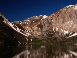 Lone Fisherman on Convict Lake Surrounded by Mountains, California, USA by Stephen Saks