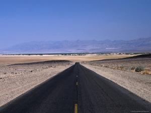 Long, Straight Road Through Death Valley, Death Valley, California, USA by Stephen Saks