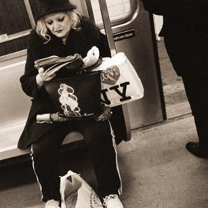 Woman Reading on a Subway with a Marilyn Monroe Purse and an 'I Love New York' Bag, 2004 by Stephen Spiller