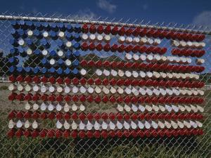 A Makeshift American Flag of Plastic Cups Decorates a Fence by Stephen St. John