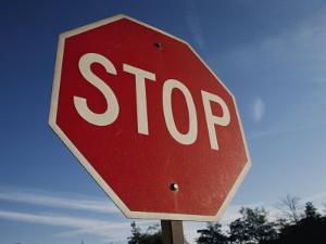 A Red Stop Sign against a Blue Sky by Stephen St. John