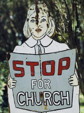 A Rusting Metal Sign Advising People to Stop for Church by Stephen St. John