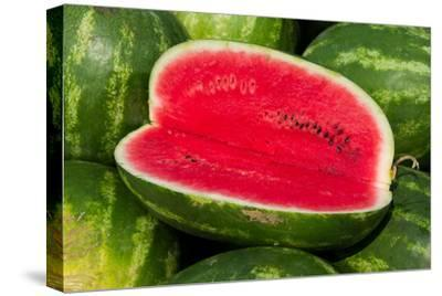 A Sliced-Open Watermelon Reveals the Bright Red Interior by Stephen St. John