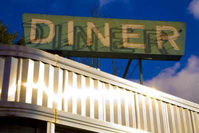 An Old Neon Diner Sign Above Glistening Reflective Aluminum Siding by Stephen St. John