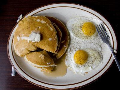 Classic Diner Breakfast of Pancakes and Eggs by Stephen St. John