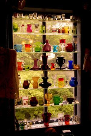 Colorful Vintage Glassware in the Rear Window of an Antique Shop by Stephen St. John