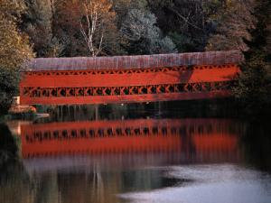 Morning Light Reflects Red Covered Bridge in River by Stephen St. John
