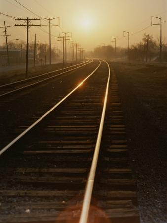 Morning Sun Shines on Railroad Tracks by Stephen St. John