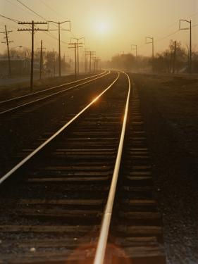 Morning Sun Shines on Railroad Tracks by Stephen St. John